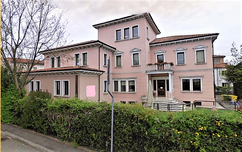Elegante palazzina storica con giardino in vendita
